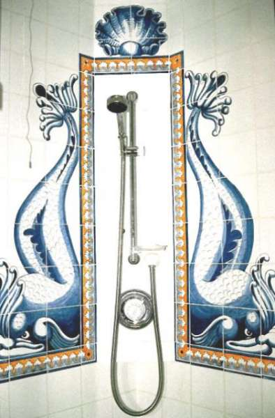 A shower with a traditional Portuguese style design on hand painted tiles.