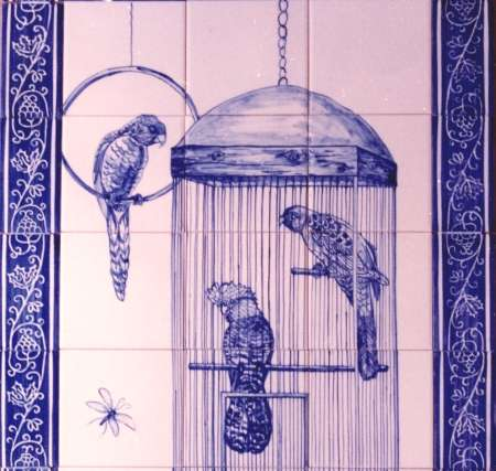 Blue parrots in cage on hand painted tiles