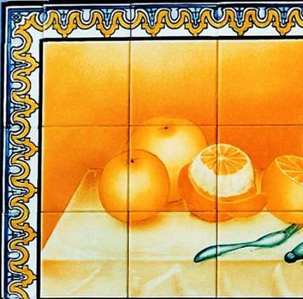 Oranges still life with borders on hand painted tiles