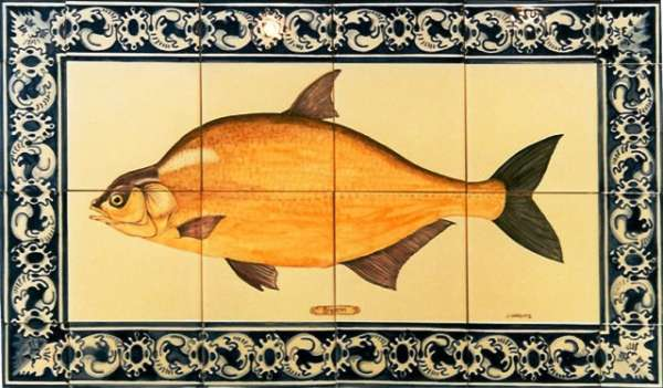 Hand painted tile panel with fish design.